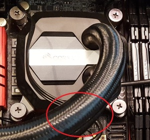 Cooling head with USB connector show (obscured by hose)